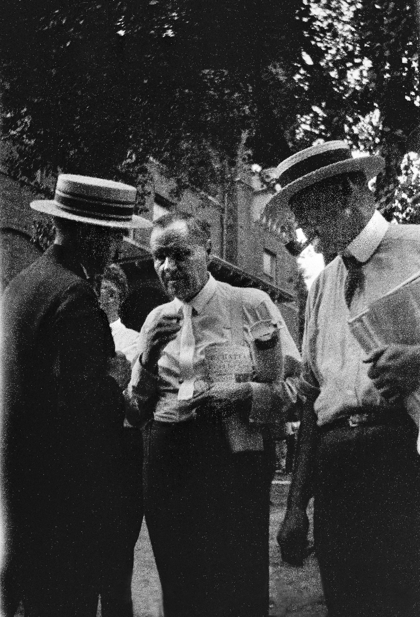 Clarence S. Darrow (center) standing near Rhea County Courthouse with  unidentified man ( a13602562309