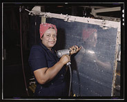 Operating a hand drill at Vultee-Nashville, woman is working on a
