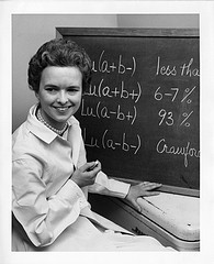 Mary N. Crawford, shown sitting next to blackboard, Smithsonian Institution Archives