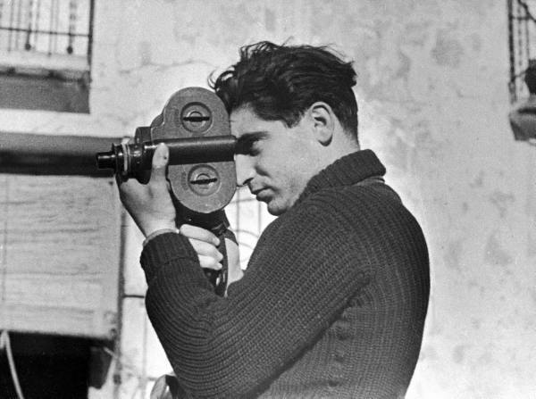 TIME photographer Robert Capa working with movie camera, 1938, LIFE photo archive, © Time Inc.