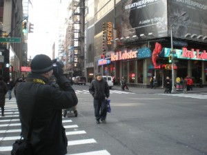 Photographer taking picture of Obama Billboard in Times Square, 2010, courtesy of Marvin Heiferman.