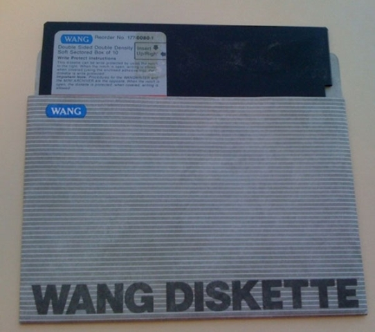 A 5.25-inch Wang floppy diskette) from a collection at the Smithsonian Institution Archives. We have not been able to view the Wang floppies yet since we do not have the equipment but are actively searching for hardware that could access these.
