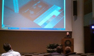 Sarah Stauderman of Smithsonian Institution Archives shows the audience a bunch of different types of videotape formats.