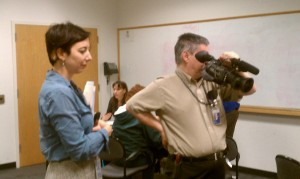 Effie Kapsalis of Smithsonian Institution Archives and video crew on hand to record interesting finds at the Archives Fair.