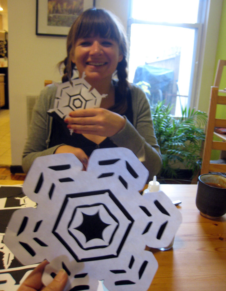 <p>Smithsonian Archives employee, Marguerite Roby, showing off her snowflake template.</p>