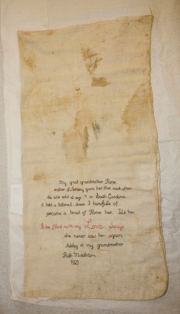 A sack inscribed with family history discovered at a Save Our African American Treasures event held at Burke High School, Charleston, South Carolina, by Michael Barnes, Courtesy of The Smithsonian'€™s National Museum of African American History and Culture.
