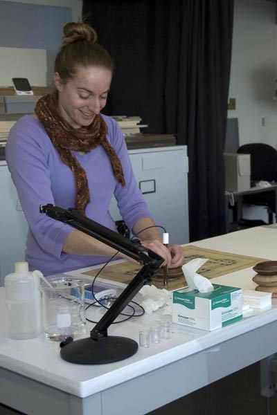 Post-Graduate Fellow in Conservation, Anna R. Friedman testing the pH of a drawing from Smithsonian