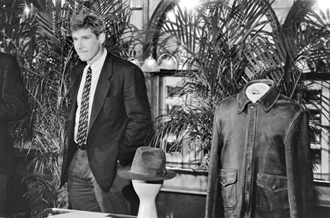 Harrison Ford donates the fedora and jacket worn by his character, Indiana Jones, at a press conference at the National Museum of American History, May 26, 1989, by Laurie Minor, Photographic negative, Smithsonian Institution Archives, Negative Number: 89-10003.21A.