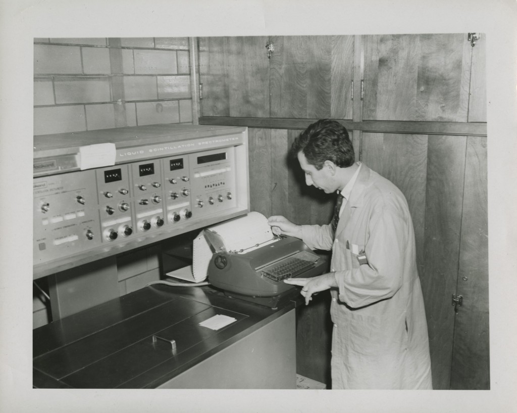 The author's father working with a Liquid Scintillation Spectrometer which apparently measured chemical compounds, University of Athens, c. 1950s, courtesy of Effie Kapsalis.