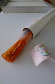 The object as received tightly rolled in mailing tube.