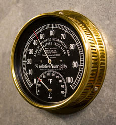 Temperature and humidity gauge in the Smithsonian Institution Archives' cold storage vault at National Museum of American History, by Ken Rahaim, Neg. no. 2007-17177.