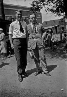 College student William Silverman (at right), standing with his former high scho