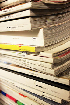 Stack of fashion magazines, by Lucy å¼µ, Creative Commons.