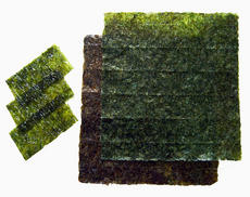 Nori - Roasted sheets of seaweed used in Japanese cuisine for sushi. The smaller ones are already se