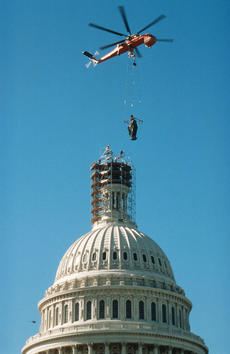 The Statue of Freedom being replaced on top of the U.S. Capitol.
