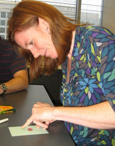 Lesley Parilla begins a fingerprint animal. Courtesy of Jennifer Wright.