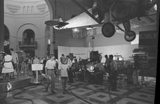 Visitors examine space program artifacts on display at the Arts & Industries Building, July 20, 1969. Hanging above is Charles Lindbergh's Spirit of St. Louis. Television cameras visible at right were broadcasting from the building as part of the coverage of the Apollo 11 lunar landing, SIA, Accession 11-009, Neg. no. OPA-1548-23.