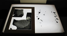 Reassembly of a glass plate negative during treatment, 2012, by Janelle Batkin, Record Unit 7370, Smithsonian Institution Archives.