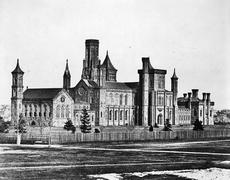 The Smithsonian Institution Building, as seen from the southwest in 1858, with the stocky South Tower, where the Beaufort Library was stored, visible in the front center. Record Unit 95, Smithsonian Institution Archives, Neg. no. MAH-36881.