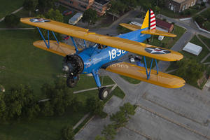 The PT–13 D Stearman  flying over Tuskegee Alabama, July 30, 2011, by Michael Barnes.