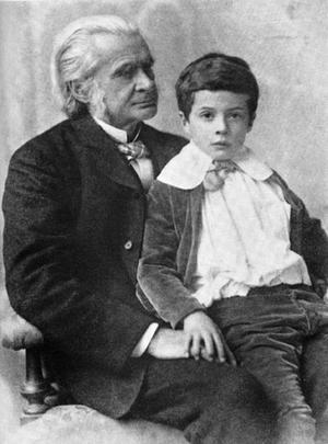 "A young Julian Huxley sitting on his grandfather's lap in 1893. His grandfather was Thomas Huxley, known as ""Darwin's Bulldog."" From Wikimedia Commons."