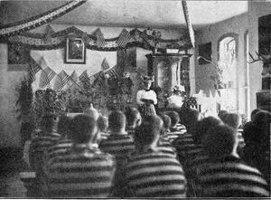 Dr. Slosson lecturing to prisoners at the Laramie Penitentiary.