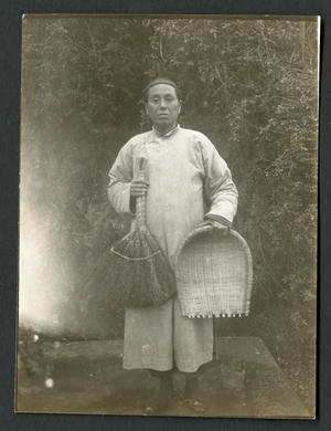 A Chinese [sic] with a broom and a dust-basket.