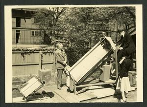 Charles G. Abbot with solar oven and solar boiler, c. 1942, black-and-white photo, SIA, Accession 12-174.
