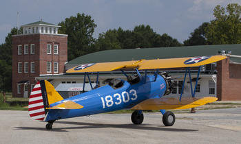 The PT–13D Stearman taxing to the Moton field museum at Moton field, July 30, 2011, by Michael Barnes.