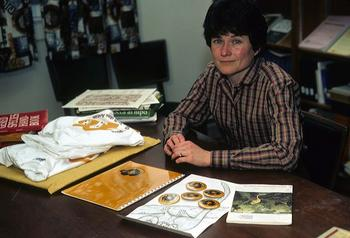 Lou Ann Dietz surrounded by educational materials about the Golden Lion Tamarin.