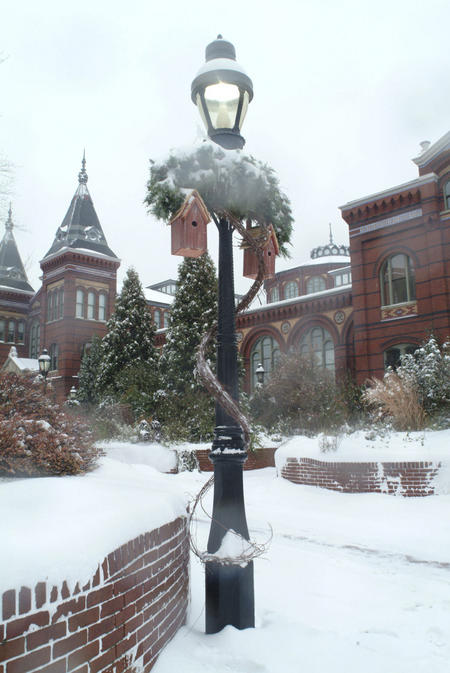 Lamp post outside the Arts and Industries Building after a snowfall.