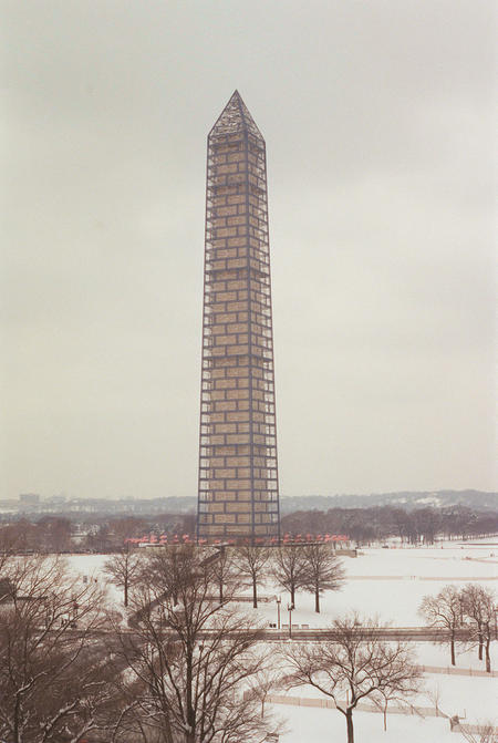 Scaffolding surrounds the Washington Monument.