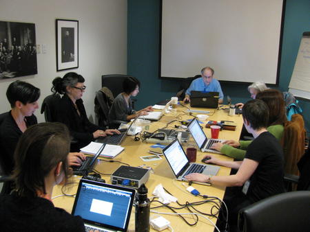 "Wikipedians and Archives staff collaborate in the edit-a-thon ""war room."""