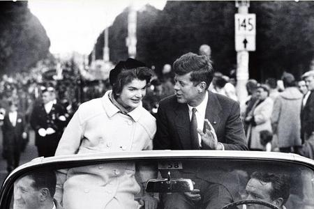 Sen. John F. Kennedy campaigns with his wife in Boston, 1958, by Carl Mydans.