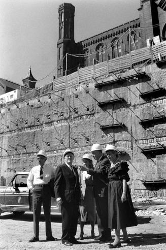 Eighth Smithsonian Secretary (1964-1984) S. Dillon Ripley (1913-2001) inspecting construction at the Quadrangle building site with (from l.), Charles Blitzer, Arthur M. Sackler, founding donor of the Arthur M. Sackler Gallery, Jill Sackler, and Mary Livingston Ripley, 1984, by Kim Nielsen, black-and-white photographic print, Record Unit 371 - Office of Public Affairs, The Torch, 1955-1960, 1965-1988, Smithsonian Institution Archives, Neg. no. 2004-10339.