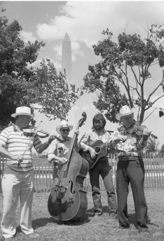At the 1985 Festival of American Folklife, the Hayride String Band performs, by Jeff Tinsley. Record Unit 371, Box 5, Folder - June 1986, Smithsonian Institution Archives, Neg. no. 85-15097-01.
