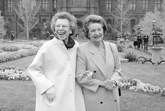 Enid A. Haupt (l.) and Lady Bird Johnson in the Enid A. Haupt Garden in the South Yard of the Castle, on their way to a celebration being held for Mrs. Johnson in the Arts and Industries Building, April 24, 1988, in honor of her 75th birthday., 1988, by Richard Strauss, black-and-white photographic print, Record Unit 371 - Office of Public Affairs, The Torch, 1955-1960, 1965-1988, Smithsonian Institution Archives, Neg. no. 88-8669-12.