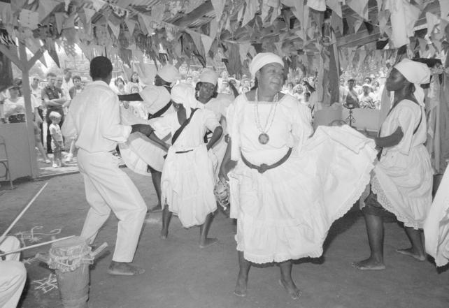 Festival participants performing a dance associated with Haitian Vodoun ritual, 1989, by Rick Vargas. Accession 93-114, Smithsonian Institution Archives, Neg. no. 89-17204.5.