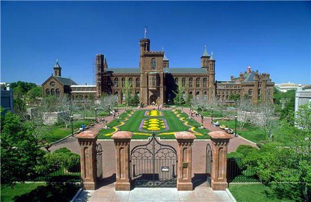 "The Smithsonian Institution Building or ""Castle's"" south entrance, viewed from Independence Avenue. The Enid A. Haupt Garden in the South Yard welcomes visitors through the gates, 1990, by Jeff Tinsley, color photographic print, Accession 11-009 - Smithsonian Photographic Services, Photographic Collection, 1971-2006, Smithsonian Institution Archives, Neg. no. 90-6258."
