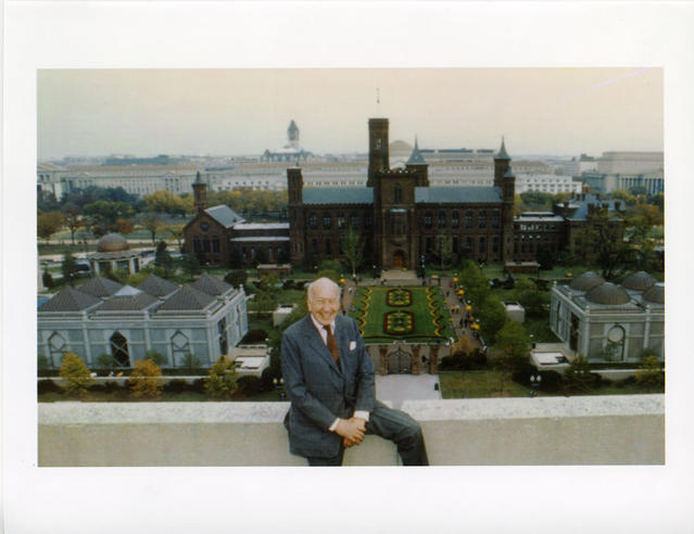 Smithsonian Secretary S. Dillon Ripley sitting on roof of building across from South Yard, 1987, color photographic print, Record Unit 7008 - Sidney Dillon Ripley Papers, 1913-1993, Smithsonian Institution Archives, Neg. no. SIA2007-0157.