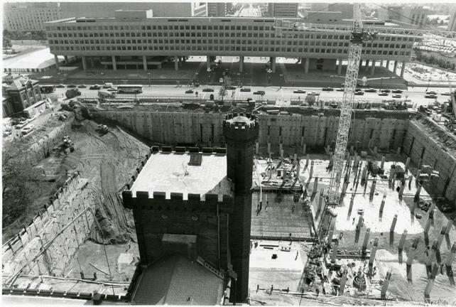 Looking down from the tallest tower of the Smithsonian Institution Building towards Independence Avenue, view is of the Quadrangle (South Yard) construction site, 1984, by Jeff Tinsley, black-and-white photographic print, Record Unit 371 - Office of Public Affairs, The Torch, 1955-1960, 1965-1988, Smithsonian Institution Archives, Neg. no. SIA2011-1329.