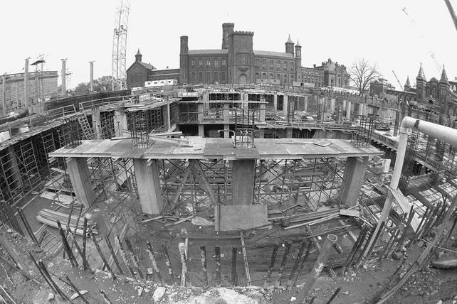 Looking from the Independence Avenue side of the Quad construction. The floor will eventually be the roof of a 10,000 square foot, two-story high exhibit gallery, 1985, by Jeff Tinsley, black-and-white photographic print, Record Unit 371 - Office of Public Affairs, The Torch, 1955-1960, 1965-1988, Smithsonian Institution Archives, Neg. no. 85-6242-28.