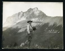 Mary Vaux Walcott, holding wild flowers in Canadian Rockies, c. 1920s, Record Unit 95 - Photograph C