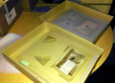 (top) A box being prepared for digitized. Notice the sheet of tissue placed over the top of the draw