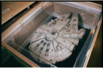 "Millennium Falcon model used in the exhibition, ""Star Wars: The Magic of Myth."" Accession 11-072: National Air and Space Museum, Exhibits Design Division, Exhibition Records, 1991-1999. Image no. SIA2016-005990. Smithsonian Institution Archives."