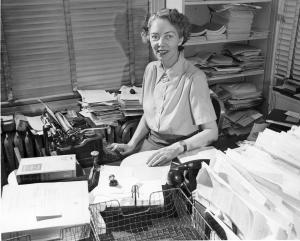 Visible on Stafford's desk at left is a copy of A Textbook of Surgery for Nurses by Edward S. Staffo