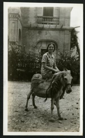 """Ruth, on the sorriest-looking donkey in town. Port-au-Prince, Haiti, August 26, 1935 taken by Richard E. Blackwelder."" caption taken directly from the back of the photograph, Accession 96-099: Richard E. Blackwelder Papers, 1926-1964, Smithsonian Institution Archives, neg. no. SIA2015-002985."