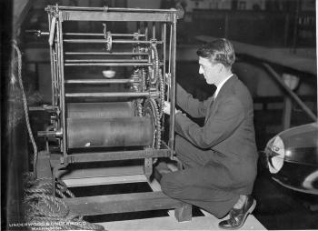 Frank A. Taylor working on a press shortly after his arrival at the National Museum in 1922, by Unde