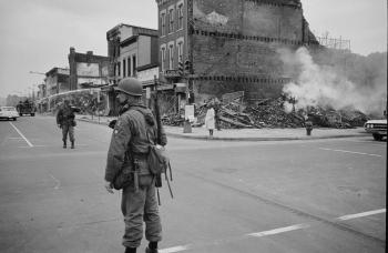 A soldier standing guard on the corner of 7th & N Street NW in Washington D.C., 1968.
