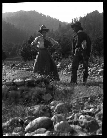 Grace Nicholson with the Karok man that she called Camp Creek George (at Klamath River), Grace Nicholson Photograph Collection, The Huntington Library, Art Collections, and Gardens